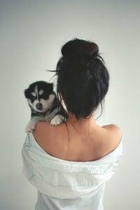 Woman holding a husky
